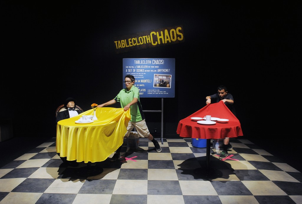 What's the trick to pulling a table cloth out from under dishes without disturbing them? Find out at the Mythbusters: The Explosive Exhibition in